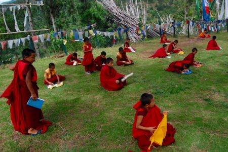 Young monks doing their daily lessons